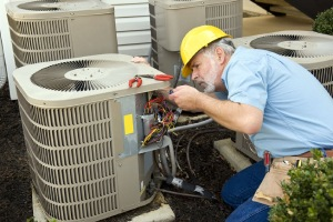 technician performing air conditioning repair in Winfield Indiana